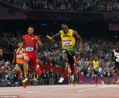 Victory again: Jamaica's Usain Bolt crosses the finish line ahead of United States' Ryan Bailey to win the men's 4 x 100-metre relay final in a world record time of 36.84 seconds.