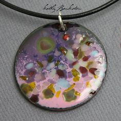 Purple and Pink Enamel Pendants~Reminiscent of a spring flower garden. Such Soft Pretty Colors! These are a base of purple with a pink layer with sprinkles of blues and golds. I make these enamel pend