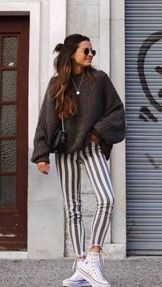 pinterest // tiiasenior - Patterned pants (specifically striped) are in! You can often see them paired with an oversized sweater or graphic tee of some sort. - Hannah Scott (11.12.17)