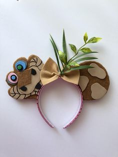 Turn heads at the parks! Step into the jungle with these Kaa Ears! Headband is one-size-fits-all! This item is MADE TO ORDER! Leaves on ears may vary. This item can be made with or without bow. Enjoy these magical ears