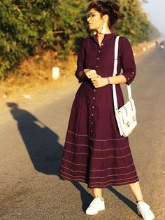 The ensemble story Purple kalidaar dress with yellow stichlines. A silhouette, shin-length brunch straight out the atelier. The designer story Silāi Studio Stylish Dresses, Casual Dresses, Fashion Dresses, Indian Designer Outfits, Indian Outfits, Indian Clothes, Kurta Designs Women, Blouse Designs, Casual Frocks