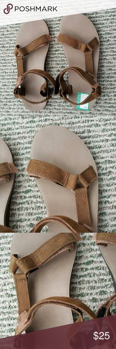 Brown leather Tevas. New! Brown leather Tevas. Size 10. Never been worn. Footbed has some scratches on it (pictured)- not really noticeable and they were there when I purchased. I like these but I want to stick with my fabric pair. Teva Shoes Sandals