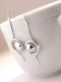 Tiny line and Point Earrings are made in Sterling by aforfebre, $30.00