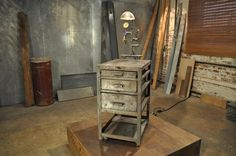 After: Simply Steampunk A pipe lighting fixture assembled by hand took this simple set of drawers from solid and industrial to a one-of-a-ki...