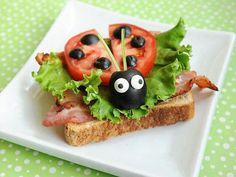 Cute food presentation for kids! Ladybug sandwich, use tomatoes and olives.