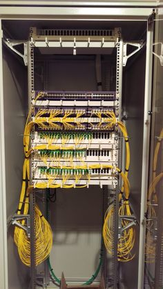 Installing fiber optic into an SFP fiber switch. They did a good job, for an ISP.