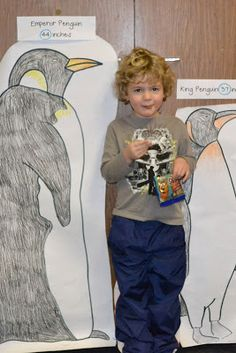 penguin math day. compare child's height to penguin