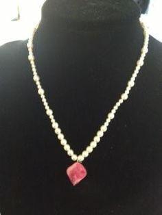 Medium / small cream pearls  Faceted red stone bead