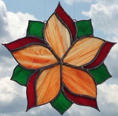 I just listed Flower Stained Glass Sun Catcher in Orange & Red on The CraftStar @TheCraftStar #uniquegifts