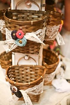 decorate baskets with pretty lace and fabric flowers- cute!