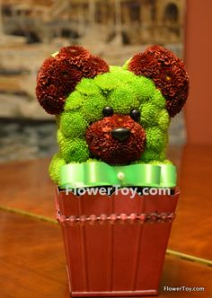 This Mini Teddy Bear arrangement is made of fresh flowers and looks like your favorite toy.