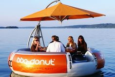 "A circular ""boat"", the bbq-donut is equipped with a barbeque grill at the centre. Now, the bbq-donut is in use across the world in over 40 countries.  The barge seats up to 10 people, and includes under-seat storage for all of your supplies.  And not to worry, the built-in table is molded with place settings to ensure food and drink stay put despite the moving current."