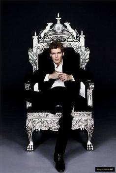 Joseph Morgan good clothing fit no ugly sleeve chest puckering... and WANT the chair.