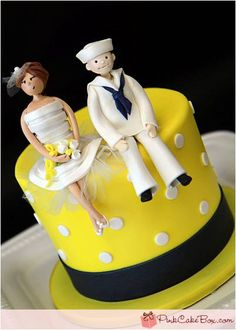 I love this cake, look at this couple, they are adorable. I like the twist from the traditional couple on the top to a more relaxed pose.