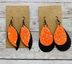 Neon orange leather earrings, wavy leaf earrings, teardrop leather earrings, halloween earrings, glitter earrings, neon earrings by 21Kulture on Etsy Navy Earrings, Polka Dot Earrings, Striped Earrings, Brown Earrings, Orange Earrings, Custom Earrings, Leaf Earrings, Leather Earrings, Halloween Earrings