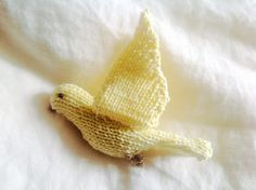 Knitted flying canary bird in cotton