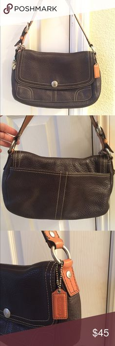COACH Chelsea Leather Shoulder Bag F12336 COACH Chelsea Leather Shoulder Bag This bag is in excellent condition has a magnetic closure for the flap. It has the identification tag inside has three pockets on the interior and one on the exterior under the flap and one on the exterior on the back of the back which is great for holding a cell phone. This bag has no flaws at all! Has some cute charms on the exterior, a coach tag that is made of leather. It has a buckle on the strap which is…