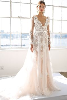 Wedding dresses with floral applications.