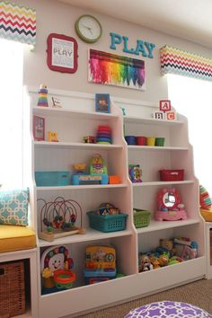 Love the colorful wall decor and those bookshelves for storage in a kids playroom!