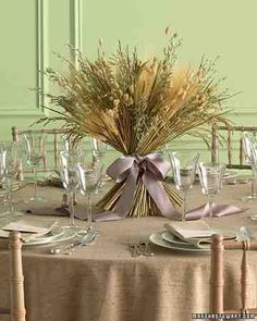 A table arrangement of grains such as wheat and dried grasses, found at craft stores, celebrates the bounty of fall. The final flourish is a luxurious satin bow.