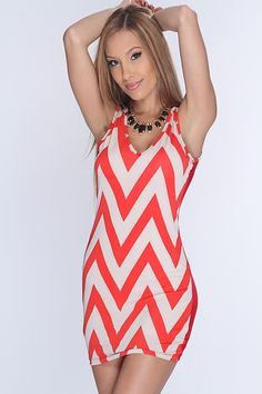 Look sizzling hot in this sexy printed dress! Pair with your favorite AMI heels and pretty accessories for a complete look! Youll have all eyes on you wherever you go! This must have dress features chevron print, v neck, sleeveless, and tight fitted to show off your sexy curves! 95% Polyester 5% Spandex. Made in USA.