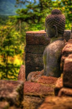 Buddha at Borobudur Temple, Javanese 9th-century buddhist temple -- Yogyakarta, Central Java, Indonesia.