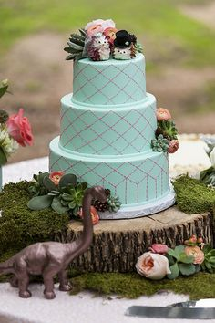 Hedgehog and dinosaur wedding cake! Cake by Michelle's Patisserie Floral from EPIC Event Design