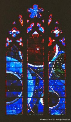 My favorite window in my favorite cathedral. The little black spot in the middle of the large circle is an actual moon rock.