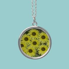 Coastal flowers Necklace  A nice necklace pendant decorated with a photo taken at the seaside. Flowers that grow in the beach.   $31.75