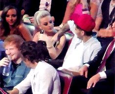 Zayn working his hand into Perrie's and it's so cute how she smiles ♡ {gif}