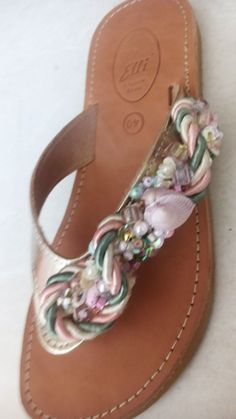 Handmade leather sandals with pearls and ribbons designed by Elli lyraraki