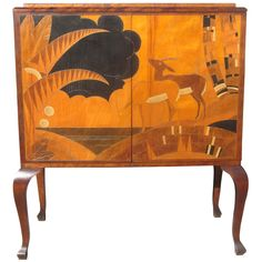 Art Deco Inlaid Cabinet in the Manner of Jean Dunand | From a unique collection of antique and modern cabinets at https://www.1stdibs.com/furniture/storage-case-pieces/cabinets/