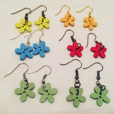 Wooden flower earrings in some colors Flower Earrings, Crochet Earrings, Pink Envelopes, Wooden Flowers, National Holidays, Wooden Earrings, Sticky Notes, Cool Items, Cute Pink