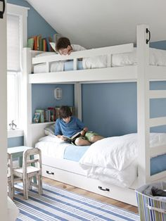 Kids' Room-he boys' room in this Vermont country home feature custom bunks that were designed with extra storage—drawers and shelves—in mind.    Bright Idea: Use a nautical bulkhead light to illuminate a tight spot on the cheap. ($12.97; homedepot.com)      Read more: Blue Rooms - Ideas for Blue Rooms and Home Decor - Country Living