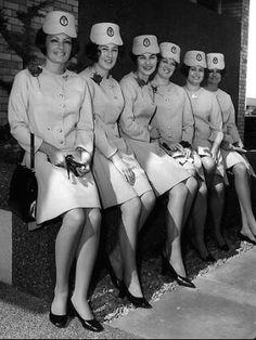 Qantas air hostesses Jennifer Cane, Rosemary England, Trina Brown, Pamela Gliddon, Christine Limpus and Pamela Larsen wearing their new uniforms after having graduated, at Qantas air base of Sydney Airport at Mascot in 1968.
