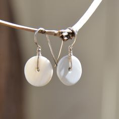 Now available online and in the store: Conch Shell Frenc....  Check it out here! http://the-elephant-story.com/products/conch-shell-french-hook-earrings?utm_campaign=social_autopilot&utm_source=pin&utm_medium=pin