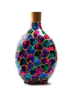Upcycled liquor bottle - hand-painted by Olia Bseiso - stained glass motif in blue, red, green, pink, purple Glass Painting Patterns, Painting Glass Jars, Painted Glass Bottles, Glass Painting Designs, Pottery Painting Designs, Glass Bottle Crafts, Wine Bottle Art, Bottle Painting, Stained Glass Paint