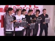One Direction at 'This Is Us' One Direction Press Conference #2, haha they eat the popcorn and then throw it on the photographers!
