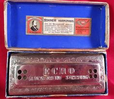 This is a very cool find. You're looking at a 1937 German made, 32 hole m.hohner glockenreine stimmung high-end harmonica, aka The Echo Harp. What's especially cool about this is that it was the version sold in Germany, so the box and harmonica are labeled differently than those sold outside of Germany. It is also a historical reminder of the dark period Germany went through under the reign of Adolf Hitler. Hohner was forced to remove the star from the logo after 1937.