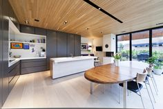 Boform Line in dark grey, with elements in American Pine. Appliances from Miele, top in Corian