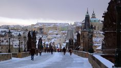Stunning photo of Charles Bridge covered in snow. Four Seasons Hotel Prague is located just next to the bridge, in the heart of the city.