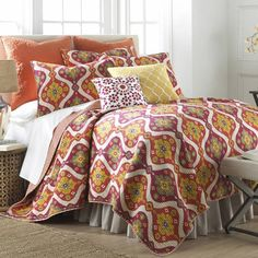 Refresh your guest room or master suite with this charming cotton quilt set, featuring an ogee motif in a warm palette.    Product: