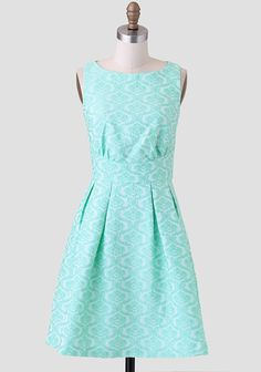 A ladylike essential, this vibrant mint-hued dress features an ornate jacquard design and box pleats at the waist for added flare. Complete with a hidden back zipper closure, this exquisite dress...