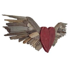 What if you made this, but drilled holes in the wings to stick Christmas lights through. Or to the heart in sea glass with light coming through.   #driftwood #DIY #light