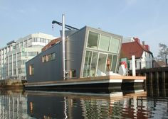 das Silberfisch Hausboot :: the  Silverfish houseboat, designed by Florian and Akkermann of Confused Direction is eco-friendly and is moored in Oldenburg Germany -- from treehugger.com