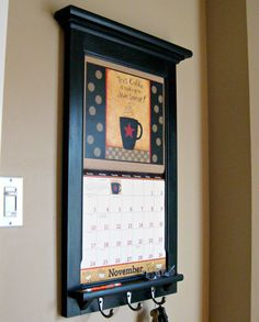 Calendar Frame organizer get ready for your 2013 Calendar - storage shelf holder and key hooks Furniture - Front Loading Calendar Frame. $145.00, via Etsy. This will help keep me on my toes from month to month with all the upcoming activities in my home.