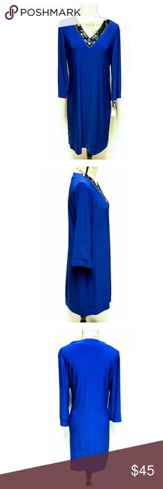 """New K Studio Collection Embellished Dress Gorgeous embellished dress by K Studio. Size 14. Color is purplish blue. Approximate measurements laying flat: length 37"""", bust 20"""", waist 19"""", sleeves 19"""". Three-quarter length sleeves. Slipcover. NWT. K Studio Collection Dresses"""