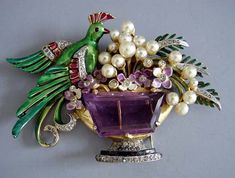 Period brooch with enameled bird of paradise, pearls, and amethyst, misc. stones and metals