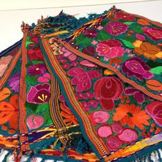 Gorgeous! These placemats come from southern Mexico and are machine stitched on top of handwoven cotton in the most lively and vibrant colors. Each one is unique and each one could be used as a center