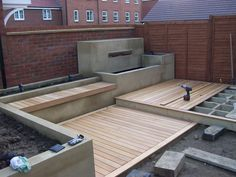 Installing Garapa deck with built in water feature, bench & planters